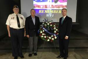 Katy VFW Post 9181 concluded its 9/11 Memorial Ceremony with a wreath presentation. From left are: Post Commander Don Bryne, Katy Mayor Chuck Brawner and District 132 state Rep. Mike Schofield, R-Katy.