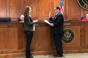 Houston attorney Frank O. Carroll is sworn in to fill the Ward A seat on the Katy City Council on Friday, Sept. 14. Carroll fills the seat vacated by J. Gary Jones, who resigned earlier this month.