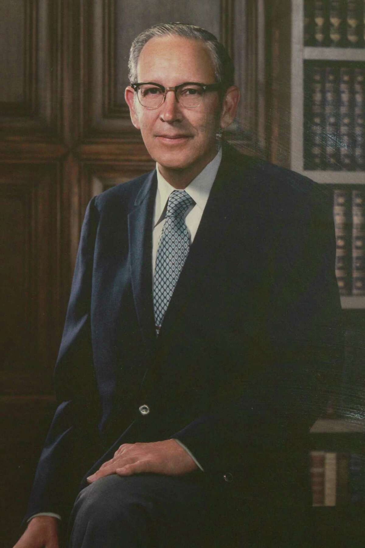 Dr. Thomas Cronin, shown in this portrait displayed at St. Joseph Medical Center in Houston, brought the idea for the first modern breast implants to Dow Corning in 1961.