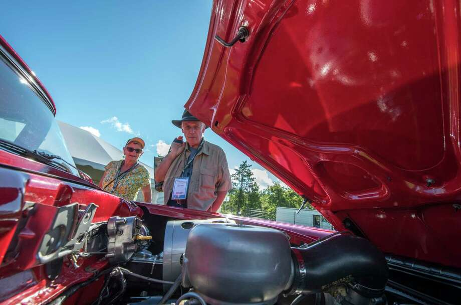 Visitors admire the power plant in a vintage Ford muscle car at the 12th Annual Hemmings Motor News Concours D'Elegance Friday Sept. 14, 2018 in Lake George, N.Y. A rally will take place today and with the Concours show on Saturday and the judging will take place on Sunday Sept. 16th.   (Skip Dickstein/Times Union) Photo: SKIP DICKSTEIN