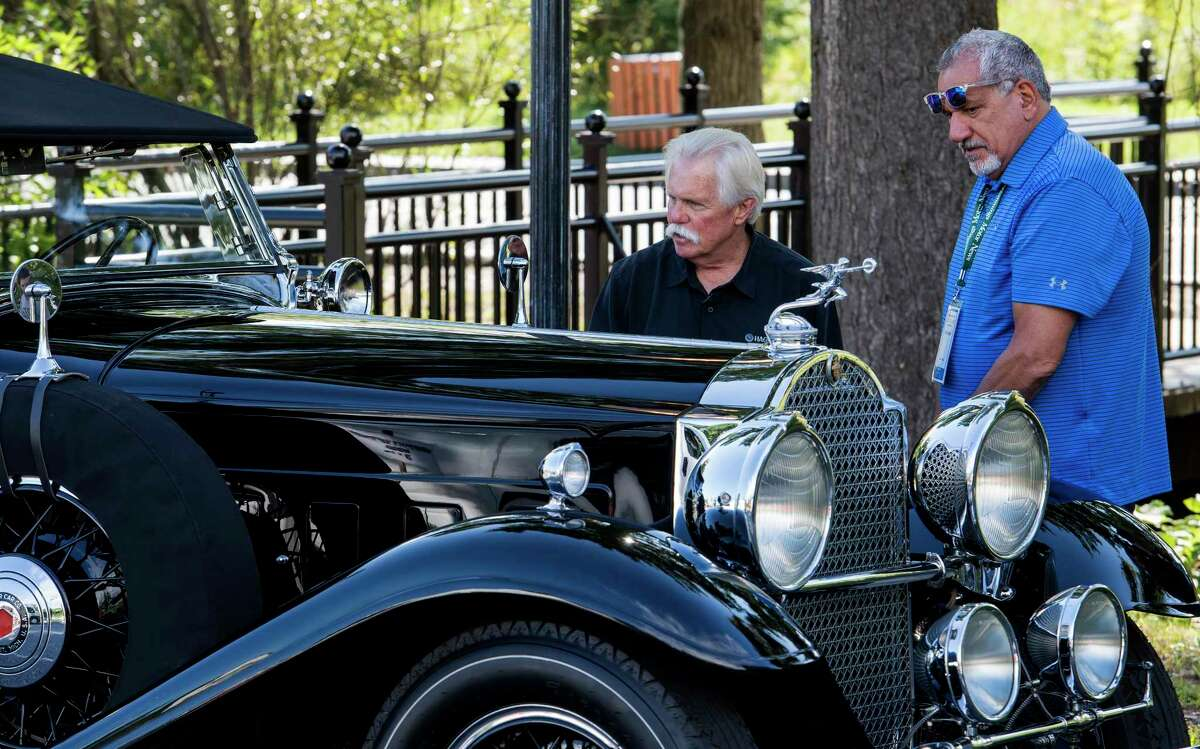 TV personality Wayne Carini discusses his 31 Packard which he brought in for the 12th Annual Hemmings Motor News Concours D'Elegance with his friend John Gagliardi Friday Sept. 14, 2018 in Lake George, N.Y. A rally will take place today and with the Concours show on Saturday and the judging will take place on Sunday Sept. 16th. (Skip Dickstein/Times Union)
