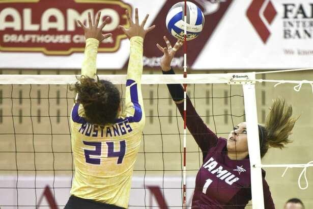 TAMIU Sammantha Herrera taps the ball over the net during a game against The University of Texas of the Permian Basin on Saturday, Sept. 8, 2018, at TAMIU.
