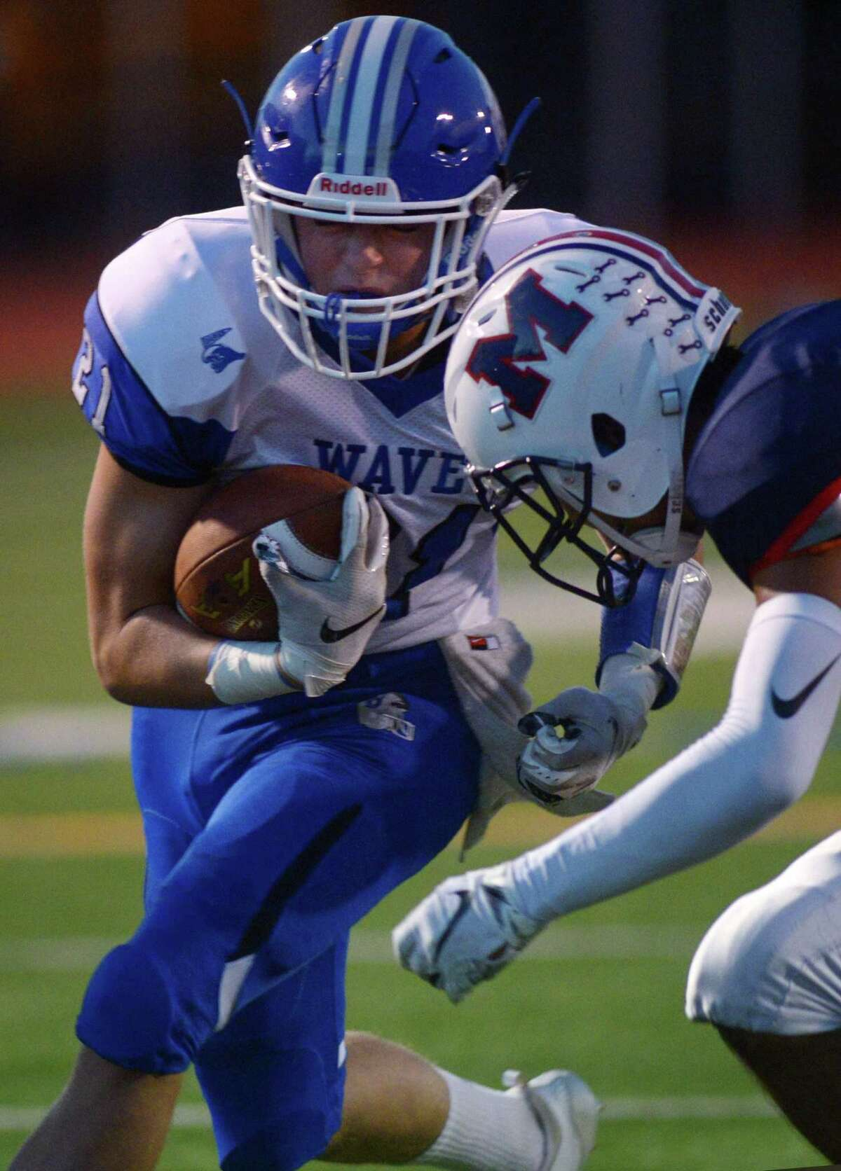 Darien High School #21 Will Kirby runs for the goal line past Senator #7 Andrew Trujillo as the Blue Wave takes on Brien MacMahon High School Friday, September 14, 2018, in Norwalk, Conn.