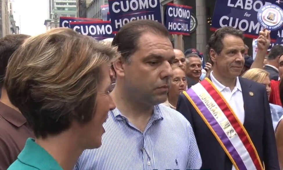 Democratic challenger Zephyr Teachout attempts to approach Gov. Andrew Cuomo during the 2014 Labor Day parade in Manhattan, only to be blocked by Joseph Percoco, who was convicted Tuesday on bribery and corruption charges. (Screenshot of video courtesy John Kenney/NYTrue.com)