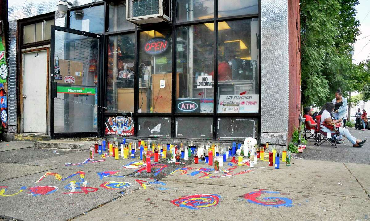 A memorial made of candles and other items has been built at the corner of Second and Judson streets so people can salute Barry Tyce, the 29-year-old man who died overnight from a gunshot inflicted earlier this week Friday Sept. 14, 2018 in Albany, NY. (John Carl D'Annibale/Times Union)