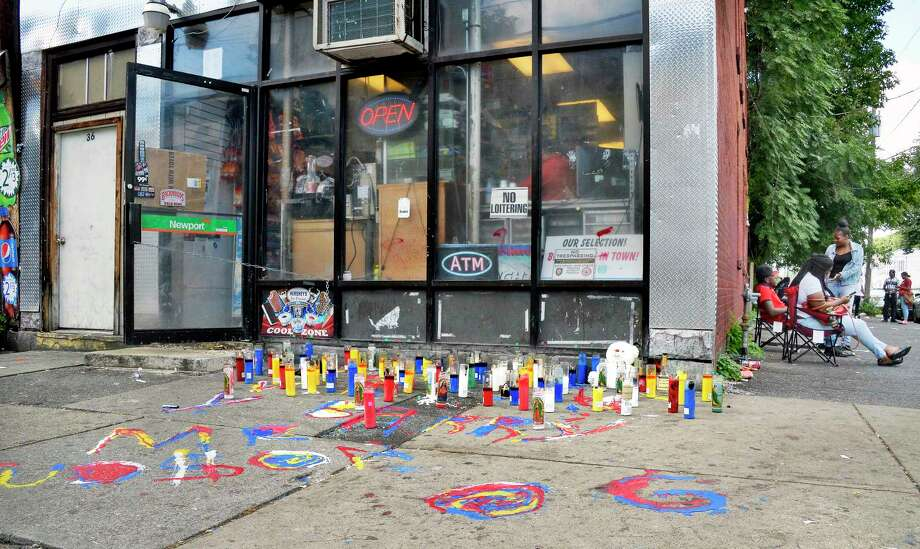 A memorial made of candles and other items has been built at the corner of Second and Judson streets so people can salute Barry Tyce, the 29-year-old man who died overnight from a gunshot inflicted earlier this week Friday Sept. 14, 2018 in Albany, NY.  (John Carl D'Annibale/Times Union) Photo: John Carl D'Annibale / 20044838A