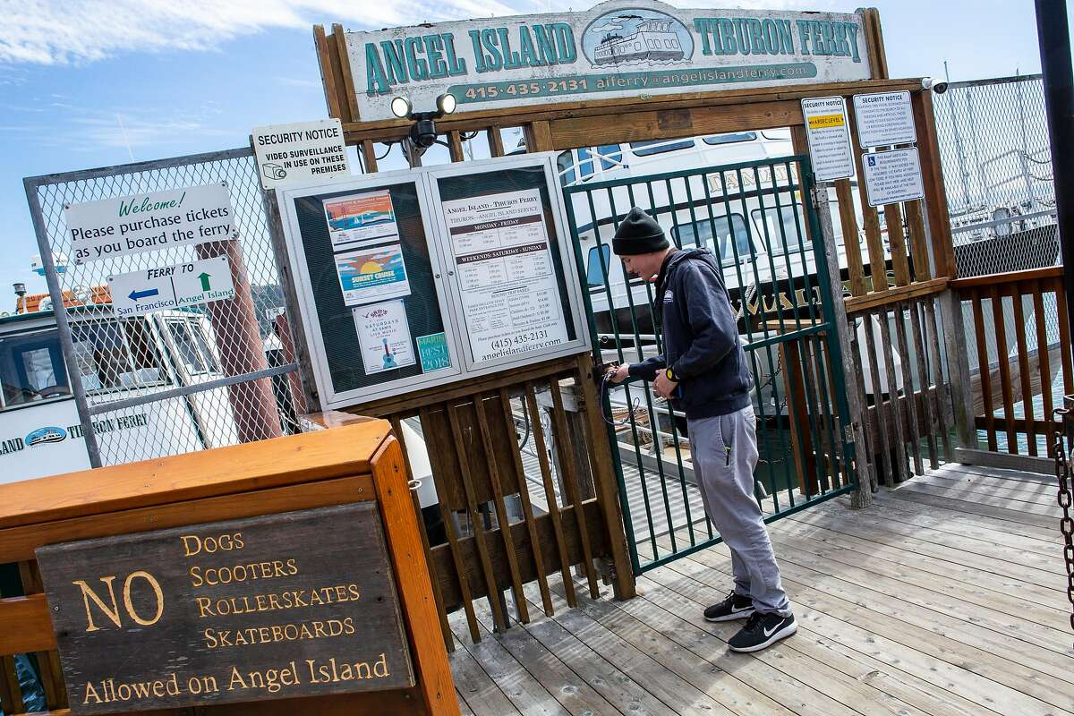 Sam McDonogh opens the gate to the Angel Island - Tiburon Ferry on Friday, Sept. 14, 2018, in Tiburon, Calif. McDonogh is part of the family business Angel Island - Tiburon Ferry.