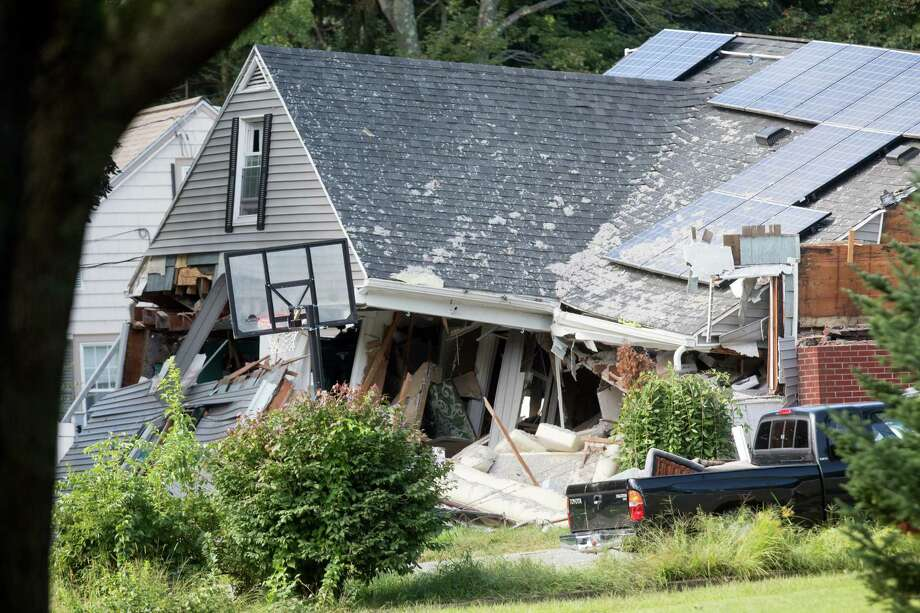 A home damaged by an explosion stands on Chickering Street in Lawrence, Massachusetts, U.S., on Friday, Sept. 14, 2018. About 8,000 people in three towns near Boston were displaced after more than three dozen explosions and fires along NiSource Inc.'s natural gas network, which killed a teenager, injured at least 13 and potentially left more than 100,000 people without power. Photographer: Scott Eisen/Bloomberg Photo: Scott Eisen / © 2018 Bloomberg Finance LP