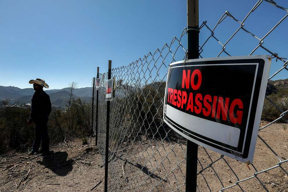 """An escalating spat pitting public access against private property rights has given rise to fences and """"No Trespassing"""" signs. Photo: Irfan Khan / Los Angeles Times"""