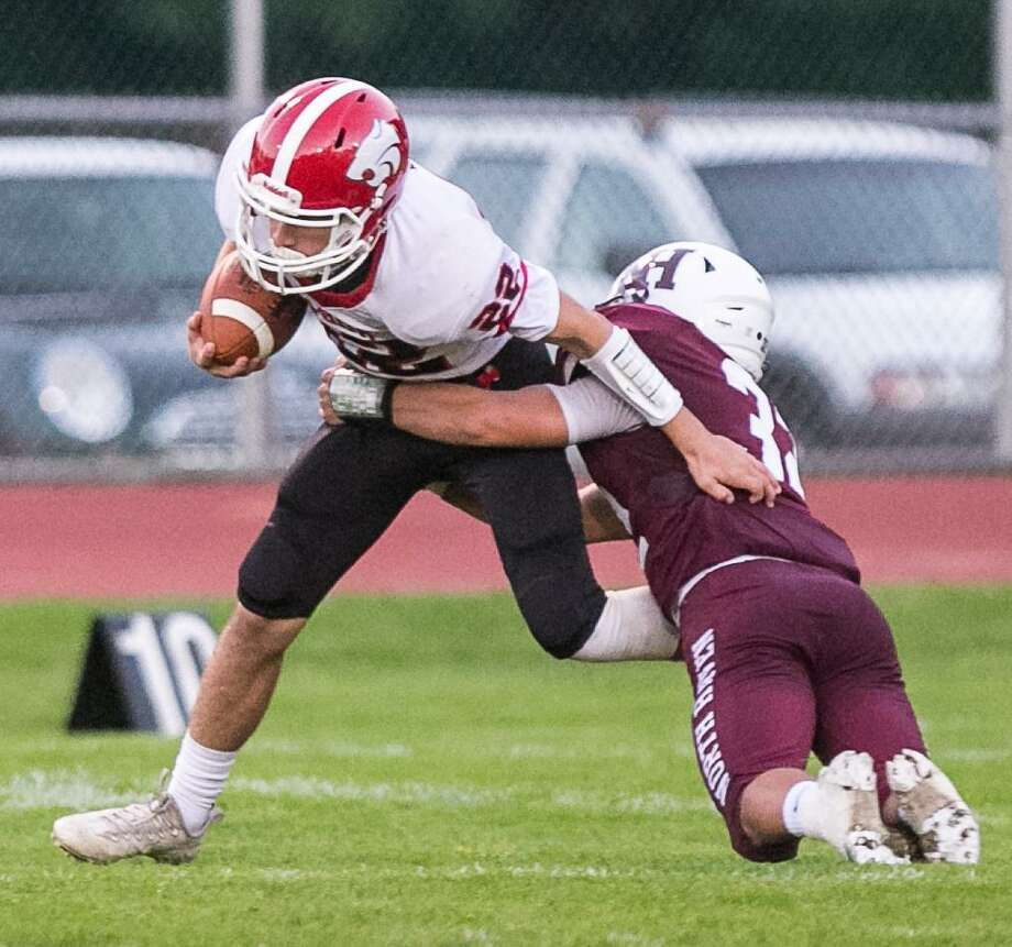 Masuk's Daniel Verrastro battles to get past North Haven defender Devan Brockamer Friday in North Haven. Photo: John Vanacore / For Hearst Connecticut Media / (c)John H.Vanacore/For Hearst Connecticut Media