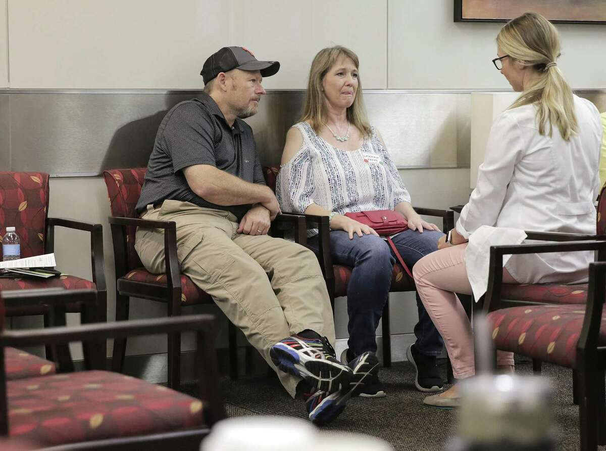 LaDonna Fryer and her husband, Brett of Sundown, Texas listen to a therapist at the Houston Methodist ALS Clinic on Friday, Sept. 7, 2018 in Houston. LaDonna, was diagnosed with ALS, and the couple made the nine-hour drive to the clinic for the first time.