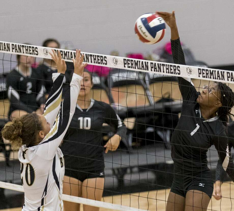 Chyenne Brewster (1) hits the ball past a Big Spring blocker Friday night at Permian Field House. Photo: Jacy Lewis/191 News