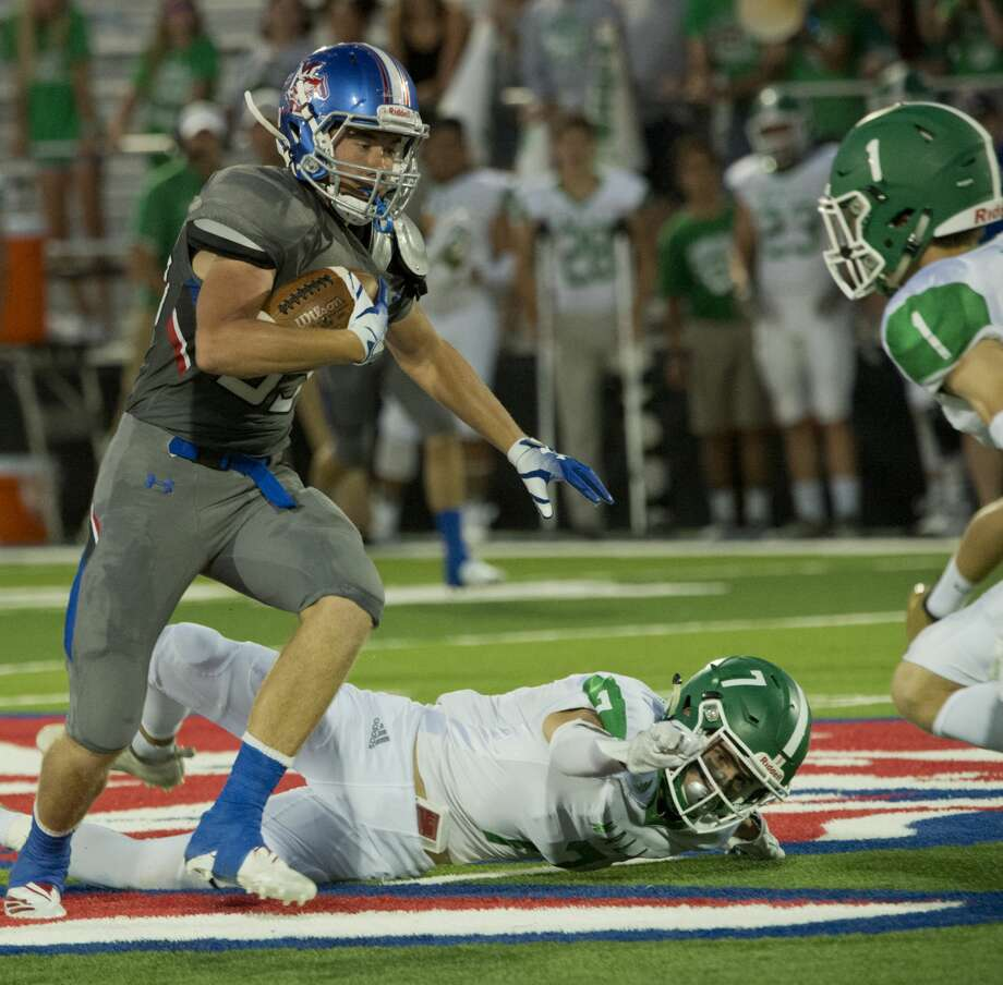 Midland Christian's Kage Gilbreath gets past Wall's Austin Gray and looks to get past Cameron Barnes 09/14/18 at Gordon Awtry Field. Tim Fischer/Reporter-Telegram Photo: Tim Fischer/Midland Reporter-Telegram