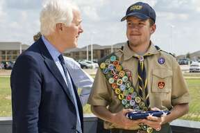 Senator John Cornyn visits with McCabe Pope, a member of Boy Scout Troop91, at the Chris Kyle Memorial on Monday in Odessa, Texas.