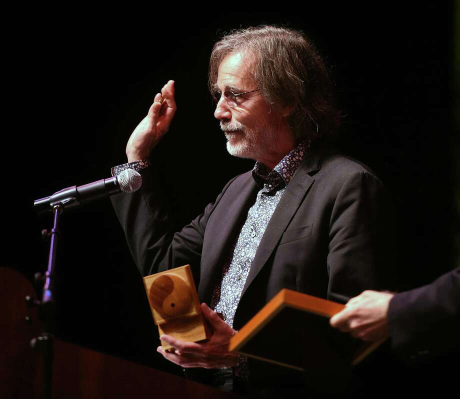 Jackson Browne accepts the Gandhi Peace Award from Promoting Enduring Peace at the Lyman Center for Performing Arts at Southern Connecticut State University in New Haven Friday. Photo: Arnold Gold / Hearst Connecticut Media / New Haven Register