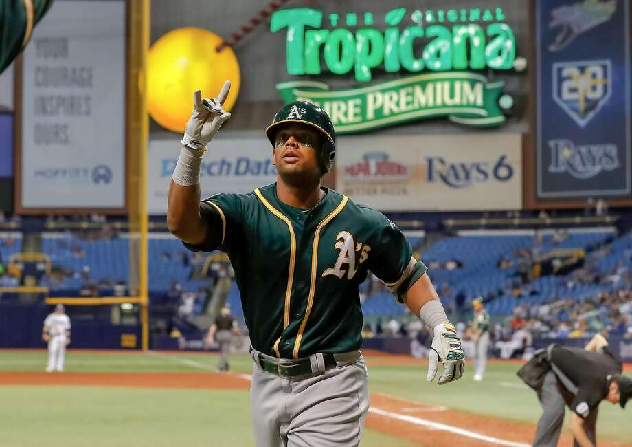 ST. PETERSBURG, FL - SEPTEMBER 14: Khris Davis #2 of the Oakland Athletics celebrates after his home run in the tenth inning of a baseball game against the Tampa Bay Rays at Tropicana Field on September 14, 2018 in St. Petersburg, Florida. (Photo by Mike Carlson/Getty Images) Photo: Mike Carlson / Getty Images