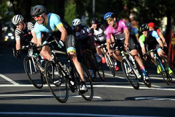 Riders turn the corner from Temple Street onto Chapel Street during the New Haven Grand Prix in downtown New Haven Friday. The twilight bicycle race and street festival will also take place today.