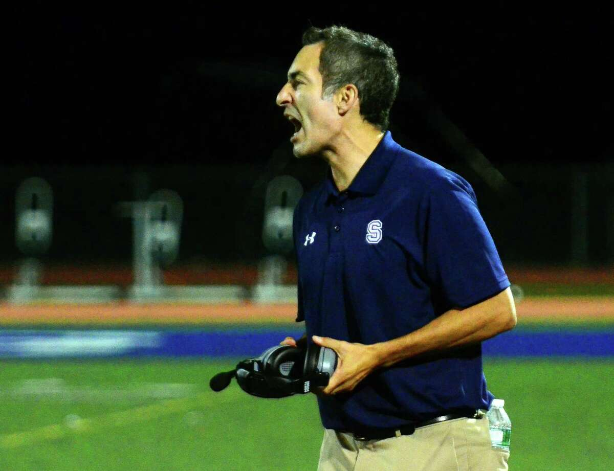 Staples Head Coach: Phil Treglia during high school football action against Wilton in Westport, Conn., on Friday Sept. 14, 2018.