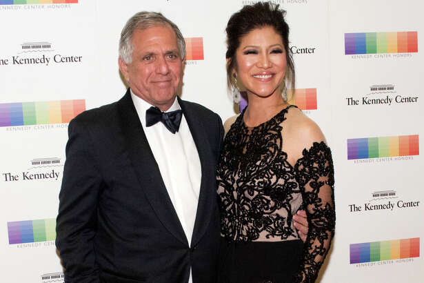"""FILE - In this Dec. 2, 2017 file photo, Les Moonves, left, and his wife Julie Chen arrive for the Kennedy Center Honors gala dinner in Washington. Chen was absent from her talk CBS show, ?""""The Talk?"""" a day after a new round of sexual misconduct allegations against Moonves brought the departure of the CBS chief executive. In what was supposed to be a celebratory season premiere Monday, Sept. 10, 2018, the show's four other panelists walked out somberly without Chen, who acts as host and moderator. Sharon Osbourne choked back tears as she announced Chen would be taking time off to be with her family, and expressed support for her co-star and friend. (AP Photo/Kevin Wolf, File)"""