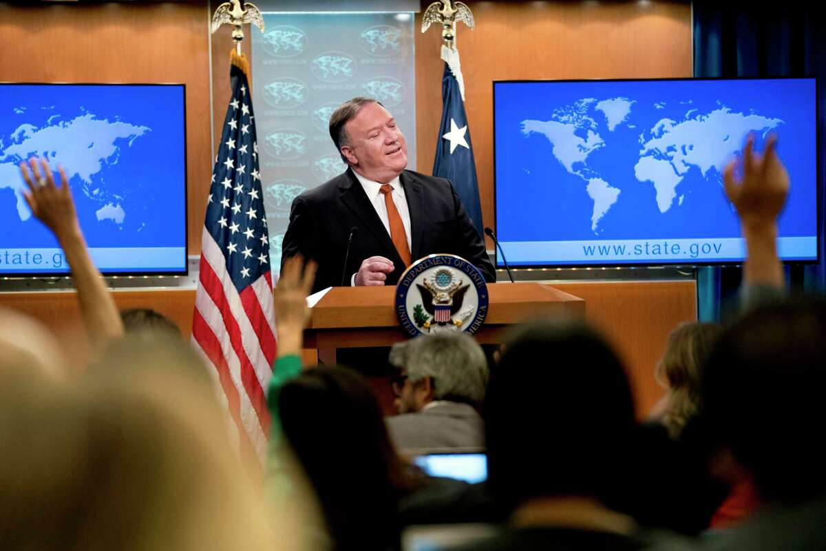 Secretary of State Mike Pompeo speaks at a news conference in the press briefing room at the State Department in Washington, Friday, Sept. 14, 2018, in Washington. Pompeo says his Obama-era predecessor John Kerry has been 'actively undermining' U.S. policy on Iran. (AP Photo/Andrew Harnik)