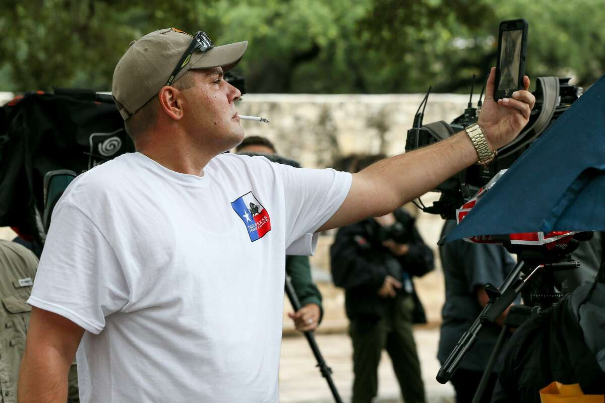 Brandon Burkhardt, president of This is Texas Freedom Force, makes a video with his phone as state Rep. Kyle Biedermann, R-Fredericksburg, holds a news conference Sept. 14 at the Cenotaph to speak against the current Alamo master plan.