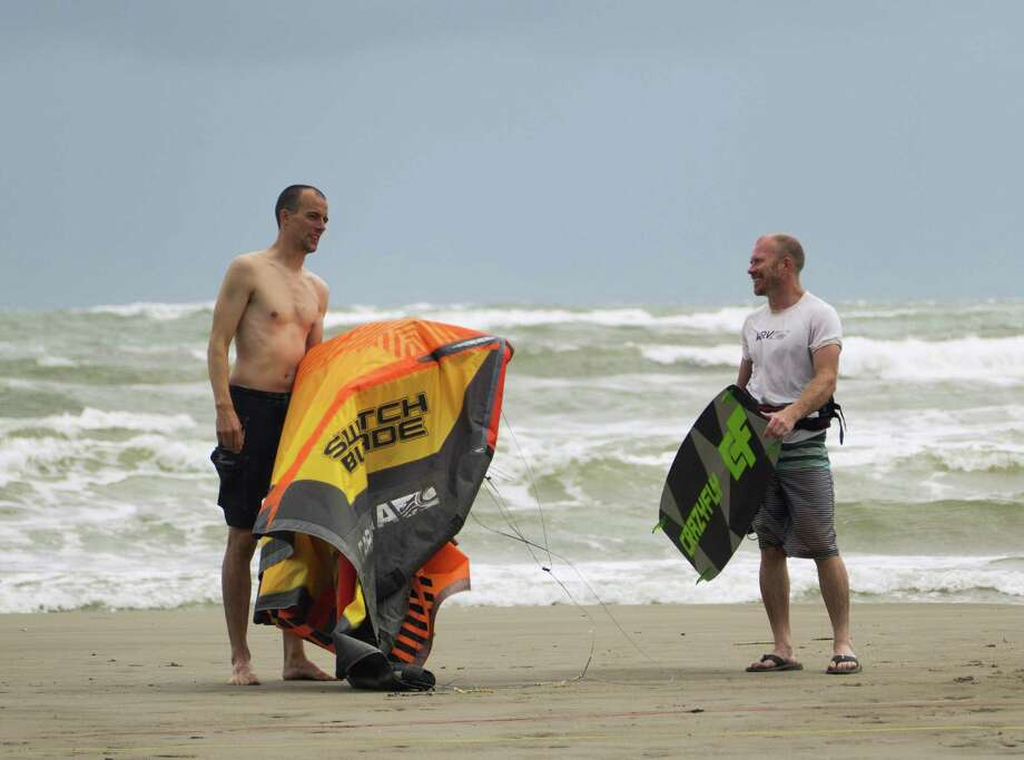 Jeff Jacobs, left, and Seamus O'Brien converse after kitesurfing in the waters of the Gulf of Mexico at Port Aransas on Friday, Sept. 14, 2018. Port Aransas was hit hard when Hurricane Harvey made landfall Aug. 25, 2017. A low-pressure area in the Gulf of Mexico failed to organize into a tropical storm, but has caused precipitation. Photo: Billy Calzada / Staff Photographer / San Antonio Express-News
