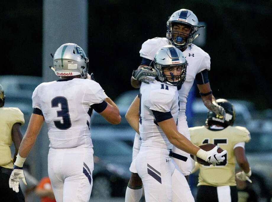 College Park wide receiver Peyton Sobosle (11) celebrates with wide receiver Jacolbi Wren after a 8-yard touchdown reception during the second quarter of a District 15-6A high school football game at Buddy Moorhead Stadium Friday, Sept. 14, 2018, in Conroe. Photo: Jason Fochtman, Houston Chronicle / Staff Photographer / © 2018 Houston Chronicle