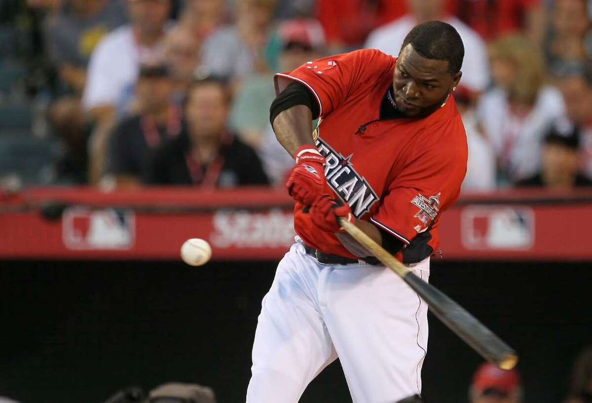 ANAHEIM, CA - JULY 12: American League All-Star David Ortiz #34 of the Boston Red Sox swings the bat during the final round of the 2010 State Farm Home Run Derby during All-Star Weekend at Angel Stadium of Anaheim on July 12, 2010 in Anaheim, California. (Photo by Stephen Dunn/Getty Images) *** Local Caption *** David Ortiz