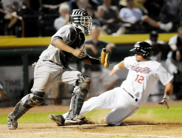 ValleyCats infielder Tyler Burnett slides into home plate, where Jamestown Jammers catcher Wilfredo Gimenez takes the throw for the forceout Monday night at Bruno Stadium in Troy.  (Luanne M. Ferris / Times Union) Photo: LMF