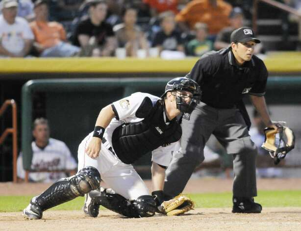 Tri-City ValleyCats catcher Michael Kvasnicka, watches along with the home-plate umpire as his drive goes foul during Monday night's 7-3 loss to the New York-Penn League rival Jamestown Jammers at Bruno Stadium  in Troy. (Luanne M. Ferris / Times Union) Photo: LMF