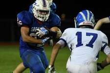 Saratoga running back Chris Klimek runs the ball as Shaker Shane Lavender poises for the stop during a game on Friday, Sept. 14, 2018, in Saratoga Springs, N.Y. (Jenn March, Special to the Times Union)