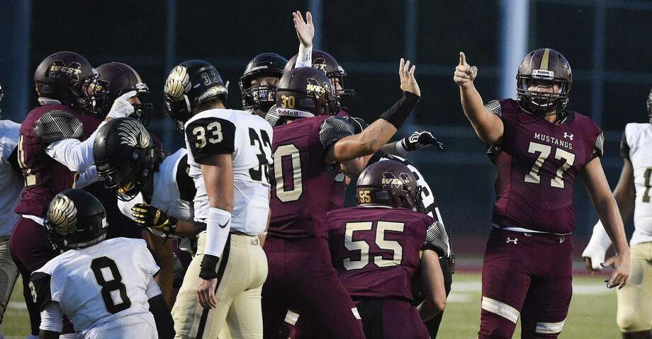 Magnolia West lineman Bryce Collier (77) signals possession after Foster's Jaden Smith (8) fumbled a kickoff during the first half of a high school football game, Friday, Sept. 14, 2018, in Magnolia, TX. (Eric Christian Smith/Contributor) Photo: Eric Christian Smith/Contributor