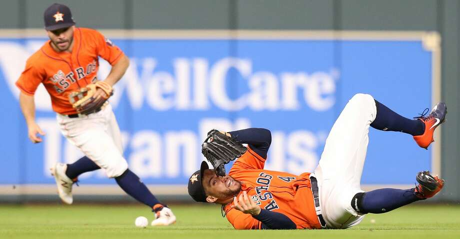 Houston Astros center fielder George Springer (4) can't get to a hit by Arizona Diamondbacks center fielder A.J. Pollock (11) in the eighth inning. Arizona Diamondbacks center fielder Jon Jay (9) scored, but Arizona Diamondbacks center fielder A.J. Pollock (11) was caught at second. The Houston Astros host the Arizona Diamondbacks at Minute Maid Park on  Friday, Sept. 14, 2018 in Houston. Photo: Elizabeth Conley/Staff Photographer