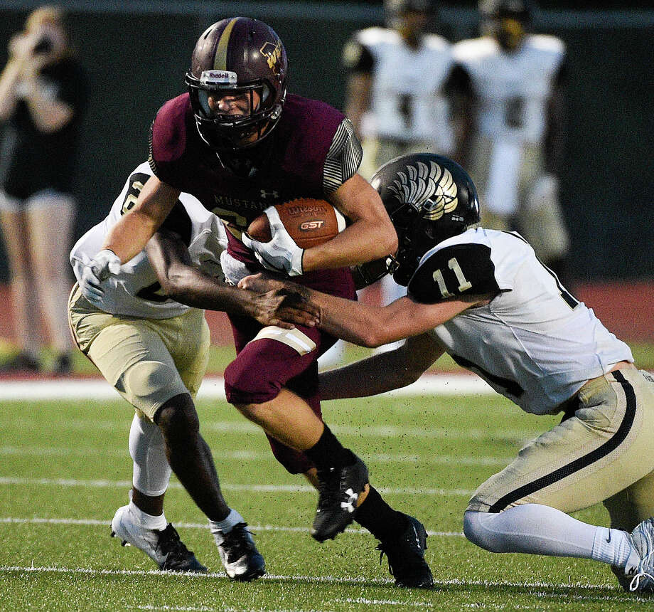 Magnolia West running back Hayden Burge, center, is tackled by Foster linebacker Jack Bibb (11) during the first half of a high school football game, Friday, Sept. 14, 2018, in Magnolia, TX. (Eric Christian Smith/Contributor) Photo: Eric Christian Smith/Contributor