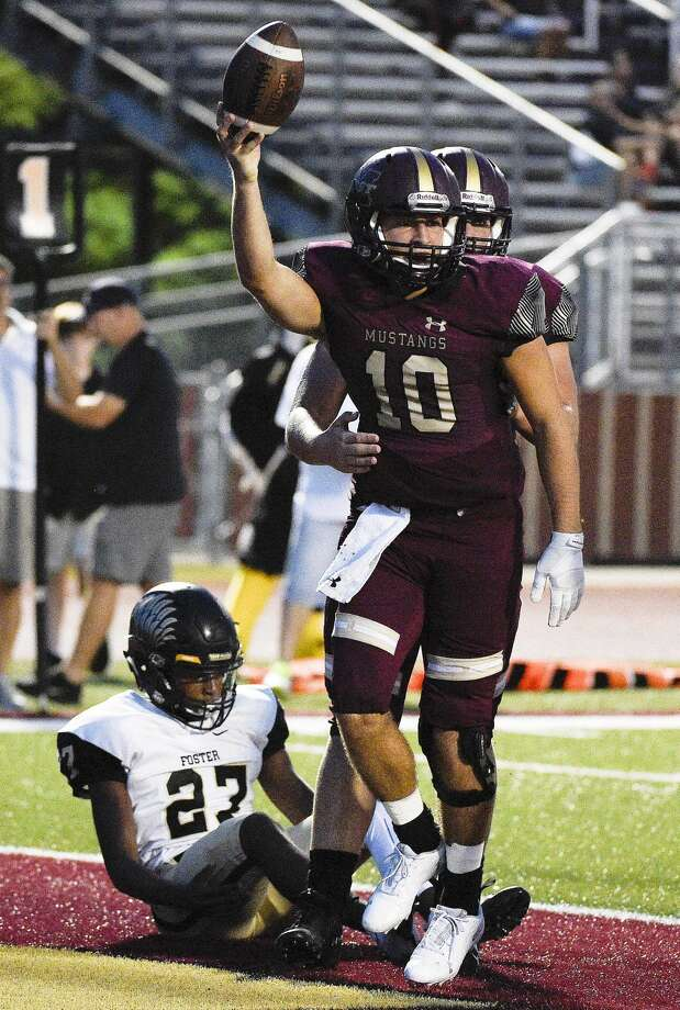 Magnolia West quarterback John Matocha (10) celebrates his touchdown, as Foster defensive back Sherman Jones (27) watches during the first half of a high school football game against Foster, Friday, Sept. 14, 2018, in Magnolia, TX. (Eric Christian Smith/Contributor) Photo: Eric Christian Smith/Contributor