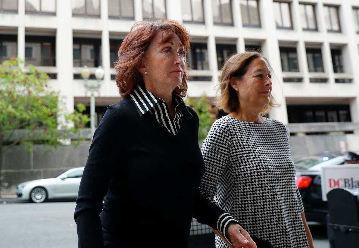 Paul Manafort's wife Kathleen Manafort, left, arrives at federal court in Washington, Friday, Sept. 14, 2018. Former Trump campaign chairman Paul Manafort is expected to plead guilty to federal charges as part of a deal with the special counsel's office. (AP Photo/Pablo Martinez Monsivais)