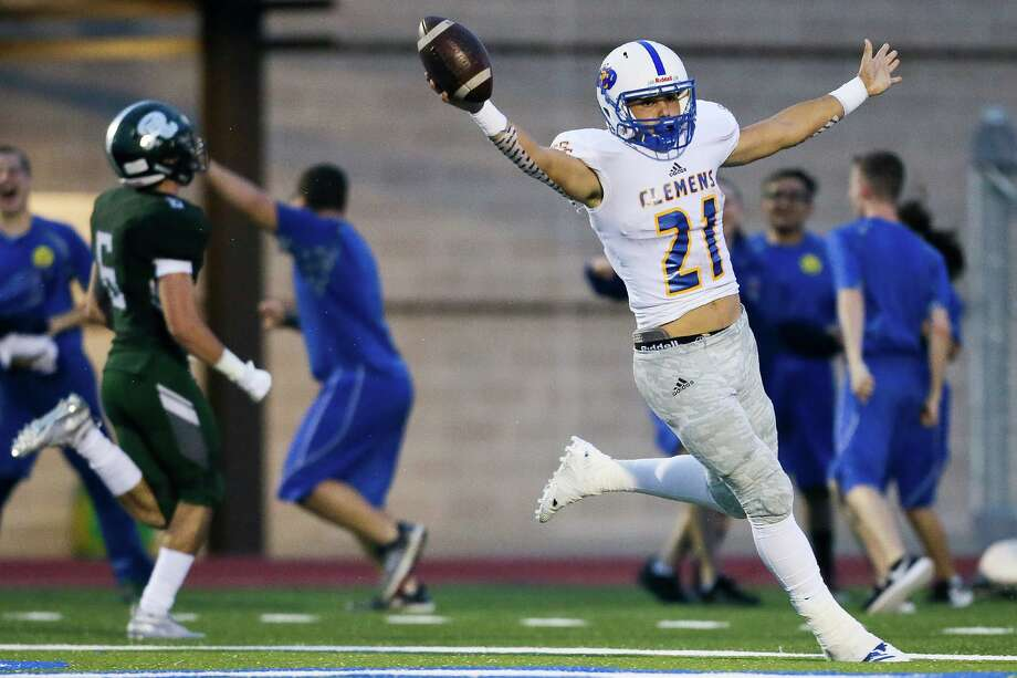 Clemens' Jackson Macias celebrates his 95-yard kickoff return for a touchdown on the opening kickoff of their high school football game with Reagan at Comalander Stadium on Friday, Sept. 14, 2018. Photo: Marvin Pfeiffer, Staff Photographer / Staff Photographer / Express-News 2018