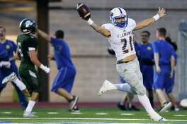 Clemens' Jackson Macias celebrates his 95-yard kickoff return for a touchdown on the opening kickoff of their high school football game with Reagan at Comalander Stadium on Friday, Sept. 14, 2018.