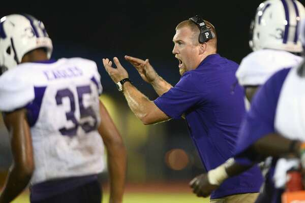 Newton assistant coach Drew Johnston fills in as head coach for his father, W.T. Johnston, against West Orange-Stark at Dan R. Hooks Stadium on Friday night. W.T. Johnston missed the game while receiving treatment for his lung disease. Photo taken Friday 9/14/18 Ryan Pelham/The Enterprise