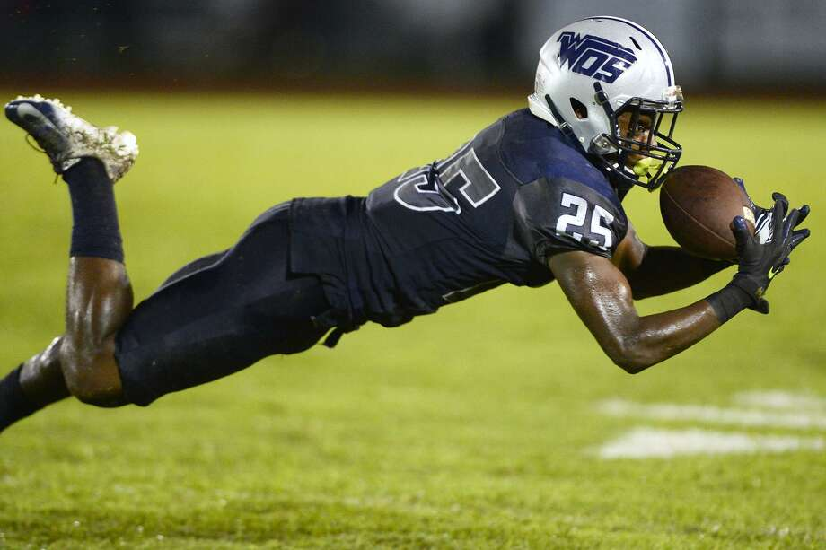 West Orange-Stark's Teshaun Teel lays out for a catch against Newton at Dan R. Hooks Stadium on Friday night. 