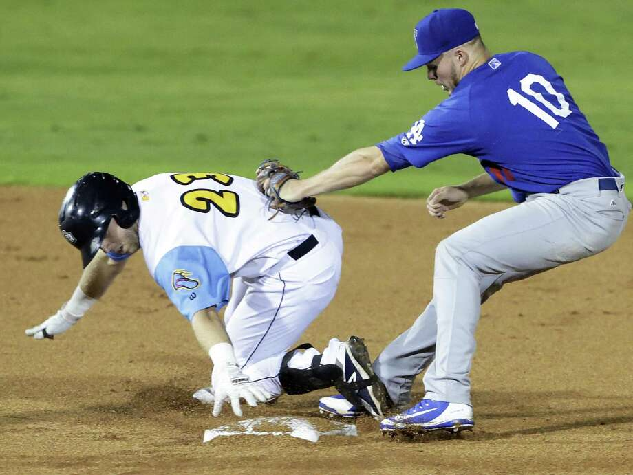 San Antonio shortstop Owen Miller is tagged with his foot off the base, but he was called safe Friday. The Missions are moving to the Triple-A Pacific Coast League next season. Photo: Tom Reel / Staff Photographer / 2017 SAN ANTONIO EXPRESS-NEWS