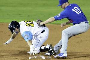 San Antonio shortstop Owen Miller is tagged with his foot off the base, but he was called safe Friday. The Missions are moving to the Triple-A Pacific Coast League next season.