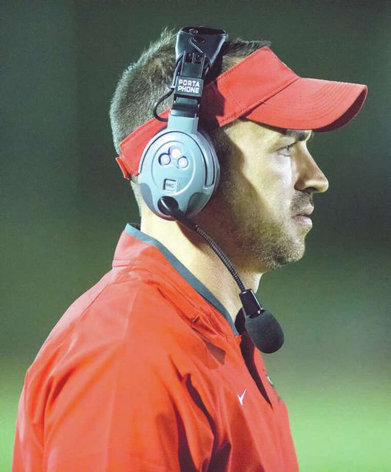 Alton coach Eric Dickerson's Redbirds dropped a 52-21 decision to Belleville West at Public School Stadium in a Southwestern Conference game that took three hours and 12 minutes to complete. Photo: Telegraph Photo