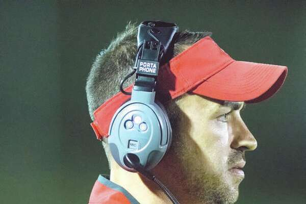 Alton coach Eric Dickerson's Redbirds dropped a 52-21 decision to Belleville West at Public School Stadium in a Southwestern Conference game that took three hours and 12 minutes to complete.