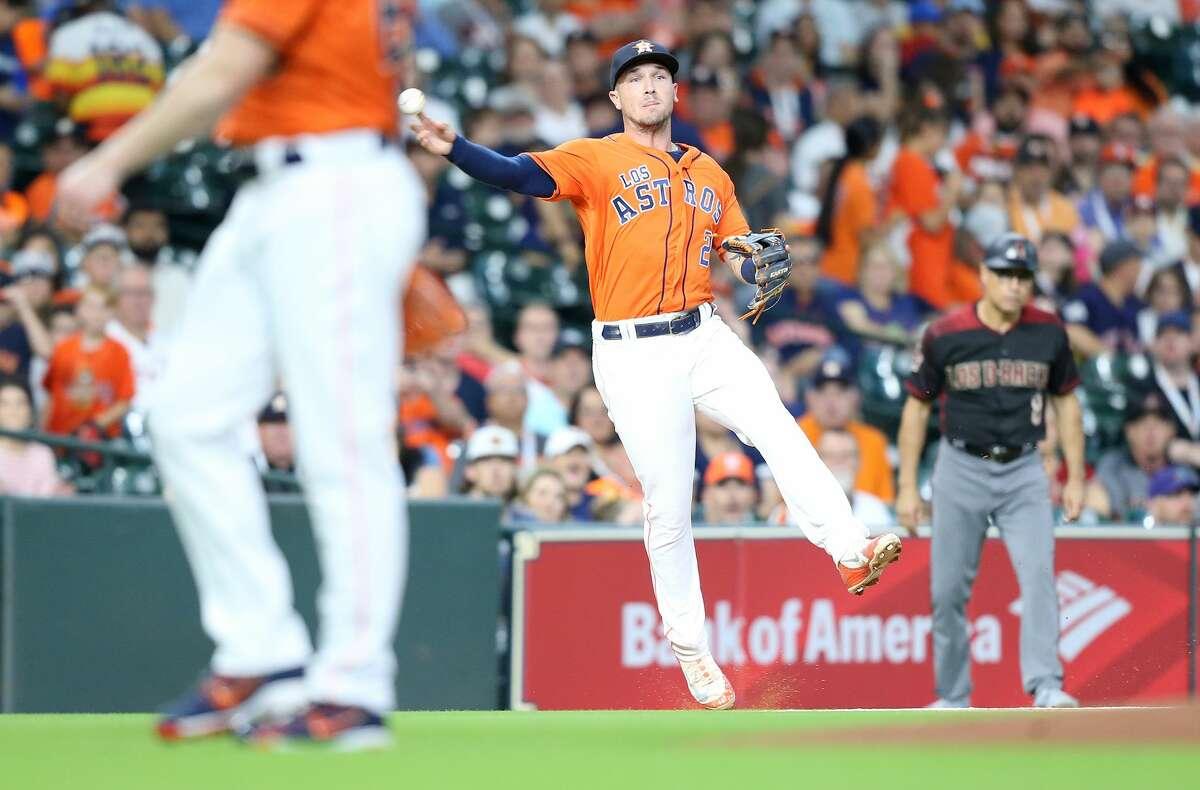 Houston Astros third baseman Alex Bregman (2) play a foul ball in the first inning against the Arizona Diamondbacks at Minute Maid Park on Friday, Sept. 14, 2018 in Houston.