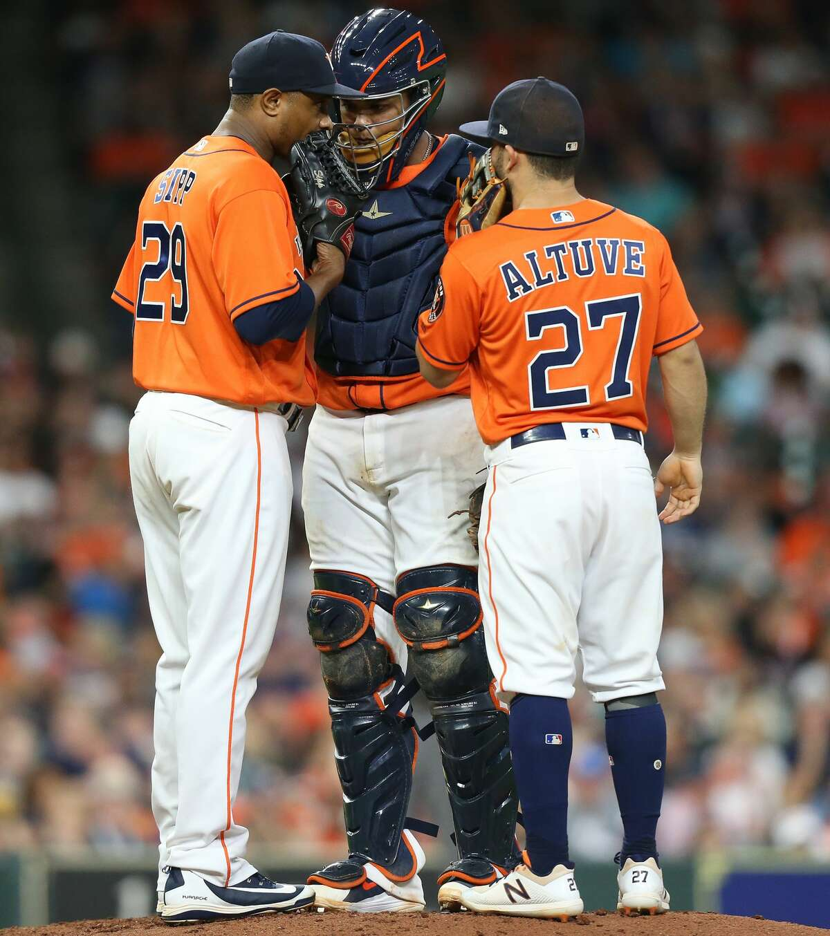 Houston Astros relief pitcher Tony Sipp (29) chats with catcher Martin Maldonado (15) and second baseman Jose Altuve (27) in the seventh inning against the Arizona Diamondbacks at Minute Maid Park on Friday, Sept. 14, 2018 in Houston.