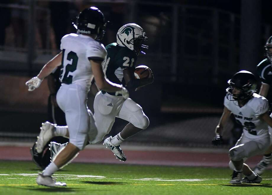 The Woodlands Christian Academy sophomore running back Dane Jackson (21) pushes for the end zone ahead of Legacy Prep freshman defender Chapman Wendell on his touchdown in the 3rd quarter of their matchup at TWCA on Friday, Sept. 14, 2018. Photo: Jerry Baker, Contributor