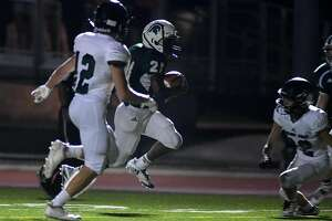 The Woodlands Christian Academy sophomore running back Dane Jackson (21) pushes for the end zone ahead of Legacy Prep freshman defender Chapman Wendell on his touchdown in the 3rd quarter of their matchup at TWCA on Friday, Sept. 14, 2018.