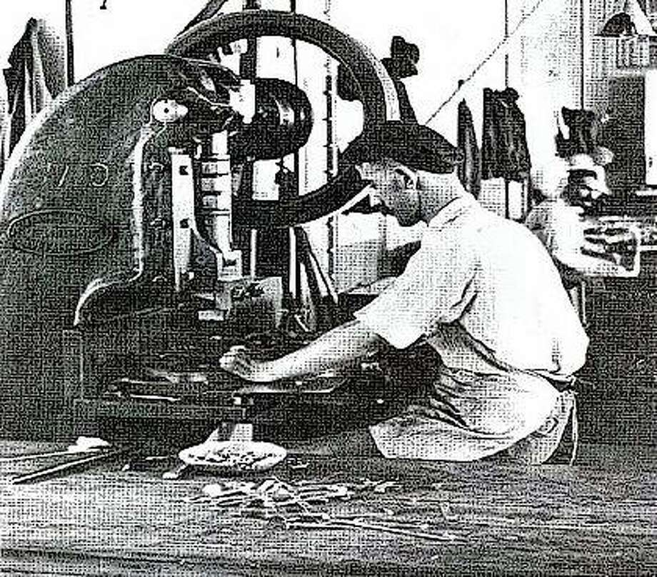 A craftsman in the tin shop makes handles for mess kits. Rock Island Arsenal made everything a soldier needed, from knives to mess kits and artillery. Photo: Photo Courtesy Rock Island Arsenal Museum