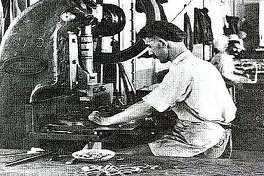 A craftsman in the tin shop makes handles for mess kits. Rock Island Arsenal made everything a soldier needed, from knives to mess kits and artillery.